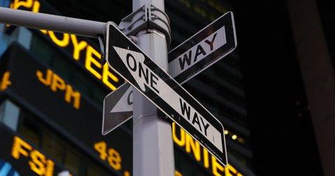 NEW YORK CITY, USA - APRIL 23, 2013 Establishing Shot Night Stock Market Shares Ticker Close-up New York City One Way Sign Lights Nasdaq ( Ultra High Definition, Ultra HD, UHD, 4K, 2160P, 4096x2160 )