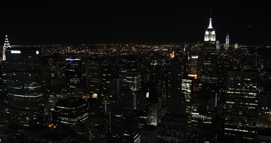 NEW YORK CITY, USA - APRIL 23, 2013 Establishing Shot Nightfall Lights New York City Downtown Skyline Aerial View Modern Skyscrapers ( Ultra High Definition, Ultra HD, UHD, 4K, 2160P, 4096x2160 )