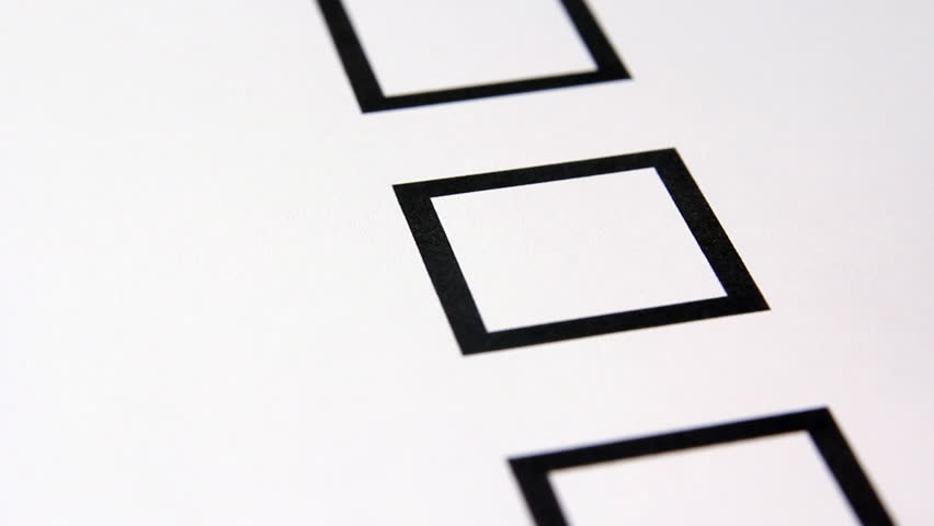 Hand checks off checklist box.