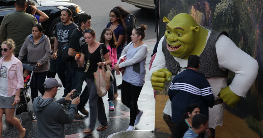 LOS ANGELES, USA - JUNE 18, 2013 People Children Take Photos Shrek Statue Hollywood Boulevard Walk of Fame Photography Establishing Shot ( Ultra High Definition, Ultra HD, UHD, 4K, 2160P, 4096x2160 )
