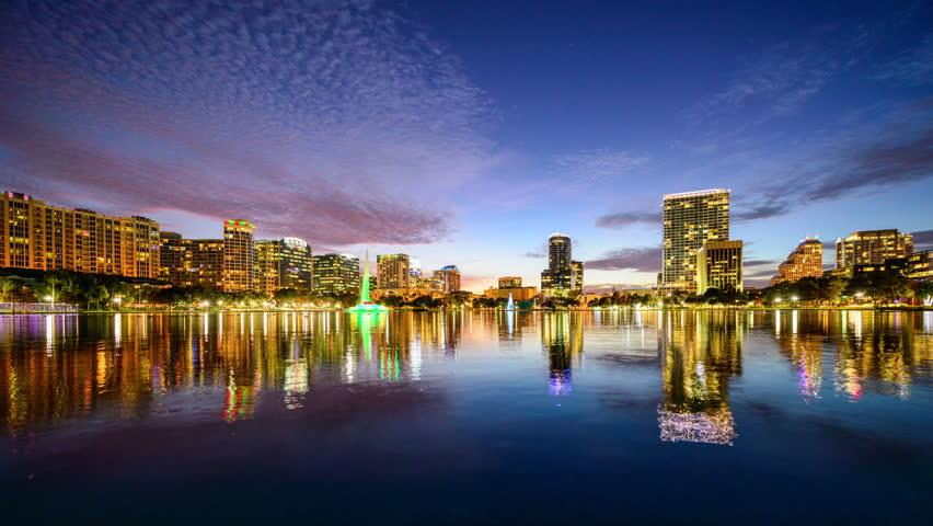 Orlando, Florida, USA downtown city skyline on Eola Lake.