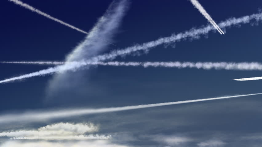 Plane trails. Airplane trails crossing each other in an intense blue sky.  HD 1280x720, 25fps. Software used Mirage (TVPaint)