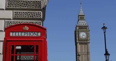 BERLIN, GERMANY - JUNE 30, 2014 Classic Red Telephone Box Closeup London Skyline Elizabeth Tower Clock Sunny Day ( Ultra High Definition, UltraHD, Ultra HD, UHD, 4K, 2160P, 4096x2160 )