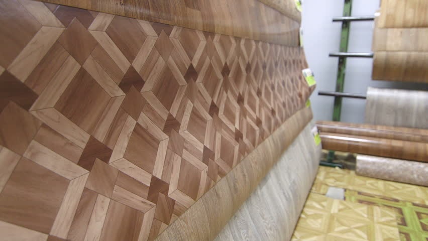 linoleum flooring samples in store showroom tracking shot stock