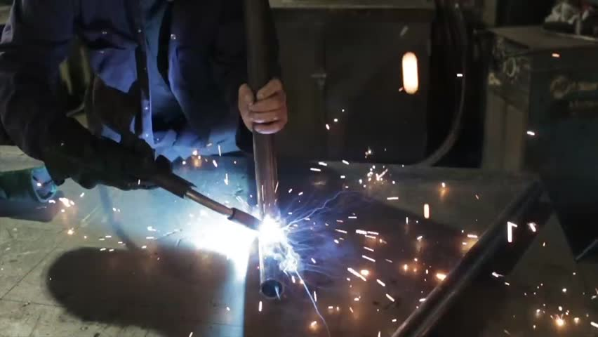 Man using welding in a metal fabricating workshop | Shutterstock HD Video #8371105