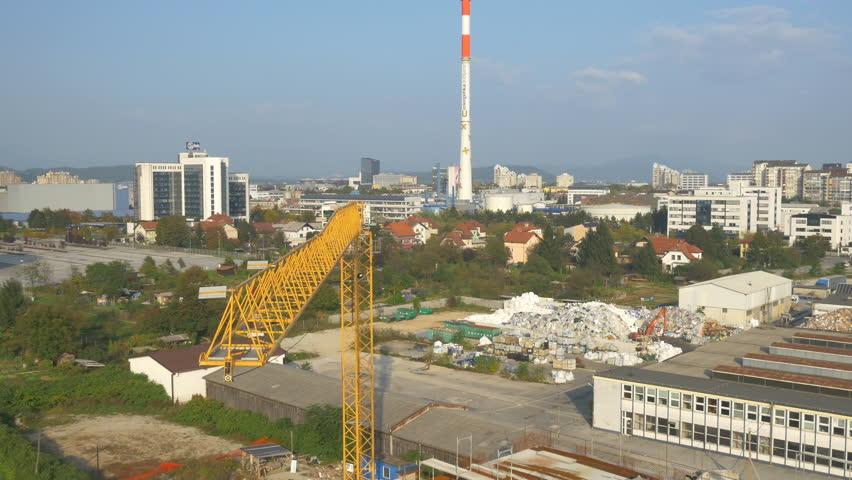 AERIAL: Flying around construction crane | Shutterstock HD Video #8378935