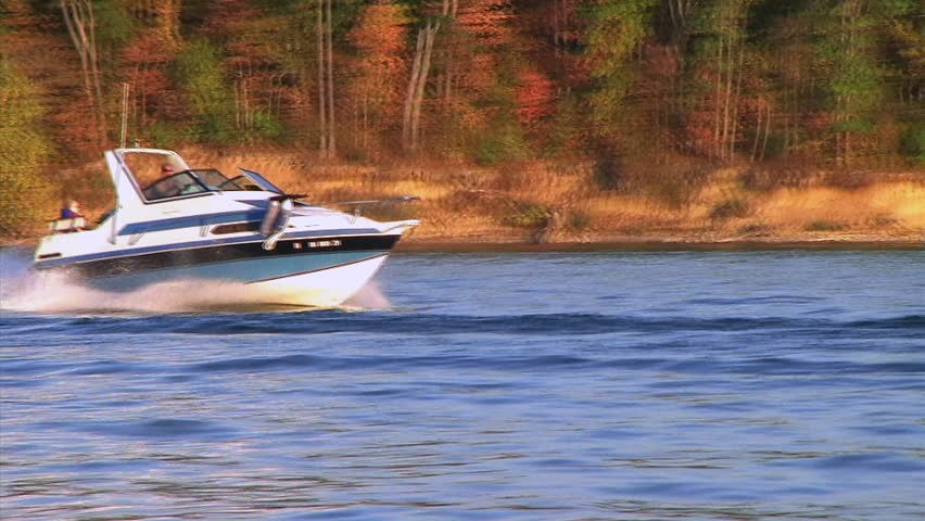 Speedboat on lake in early autumn - audio from shotgun microphone.