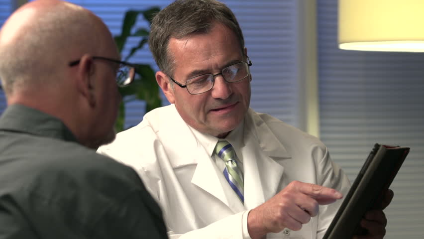 Male doctor explaining information with tablet - close | Shutterstock HD Video #8409265