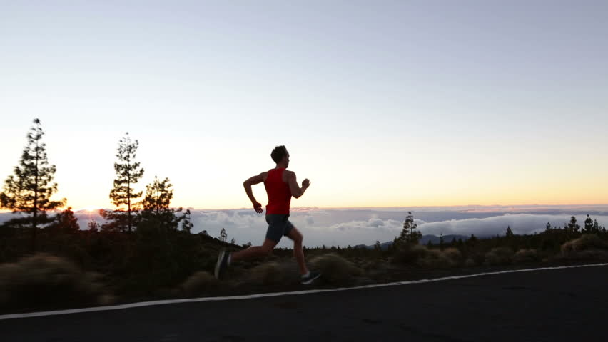 Runner man sprinting running fast on road at sunset. Male athlete sprinter running at speed on mountain road training for marathon living healthy active lifestyle in nature. | Shutterstock HD Video #8433409