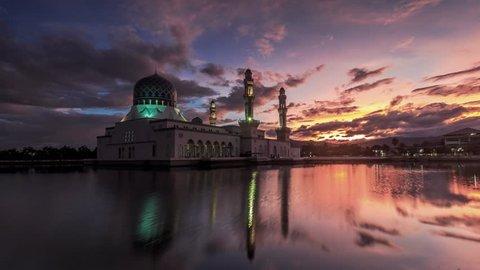 Time lapse of sunrise and scattered clouds at Likas Mosque(Masjid Bandaraya Likas), Kota Kinabalu, Sabah, Malaysia. 4K resolution, 4096x2304.