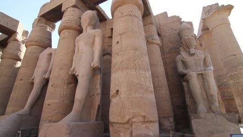 Pan of Ancient Egyptian statues and pillars at Luxor Temple in Luxor, Egypt. 1080p high definiton.