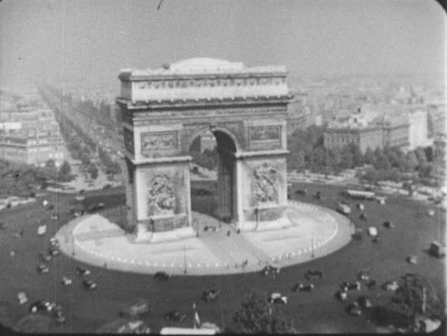 PARIS, FRANCE 1940s : The plane passes through Arc de Triomphe. | Shutterstock HD Video #8444515