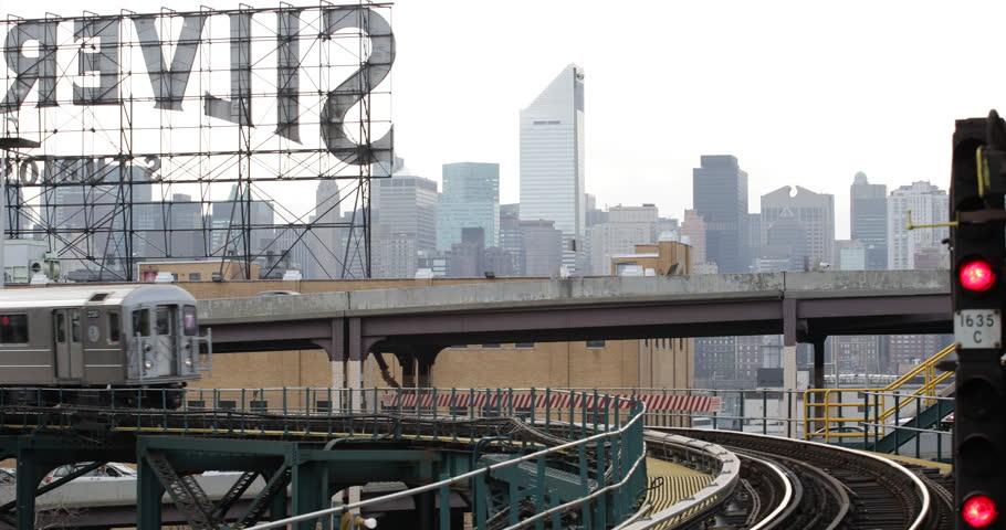 NEW YORK CITY, USA - APRIL 23, 2013 Underground Subway Train Passing Elevated Line in Queens NYC Skyline, Establishing Shot ( Ultra High Definition, UltraHD, Ultra HD, UHD, 4K, 2160P, 4096x2160 )