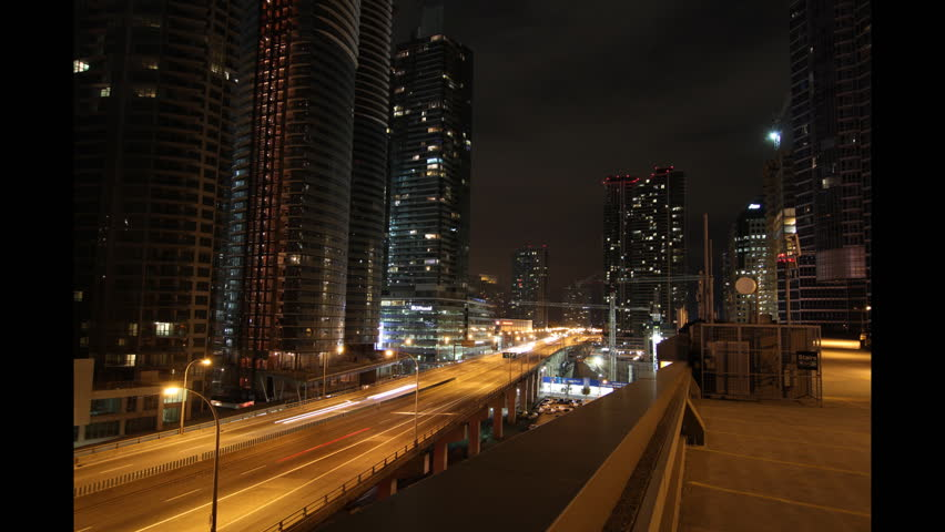 Toronto highway at night. Time lapse. Tilt up. Timelapse and tilt up of Gardiner expressway at night in downtown Toronto. Looking east. Clip is assembled from hi-res stills taken with a Canon 550D.