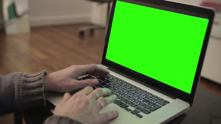 Computer green screen typing hands - 1080p PARIS, FRANCE - OCTOBER 28; Hands typing on a green screen computer - Full HD