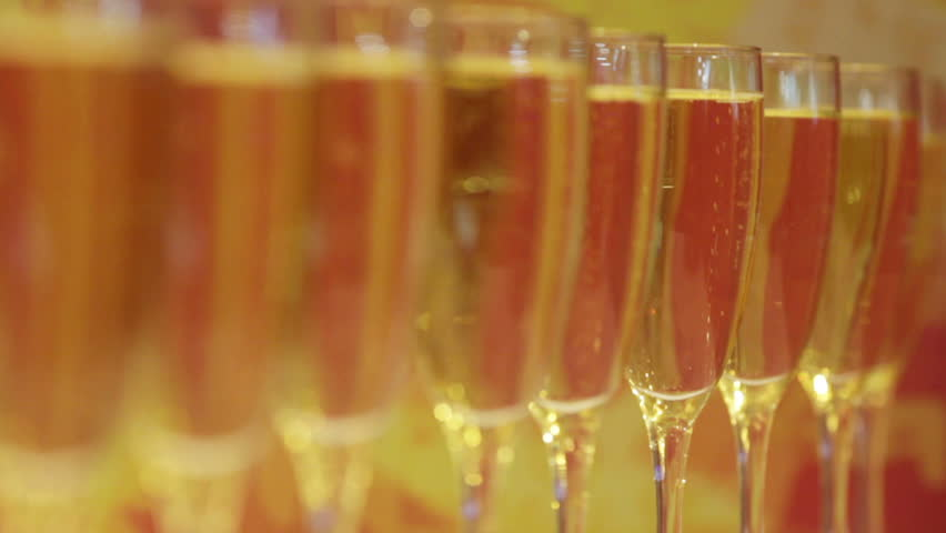 Number Of Wine Glasses With Champagne Poured   HD Stock Footage Clip