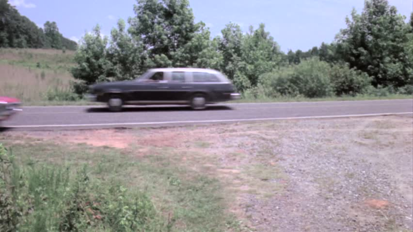 Car driving off country road into bushes | Shutterstock HD Video #8488915