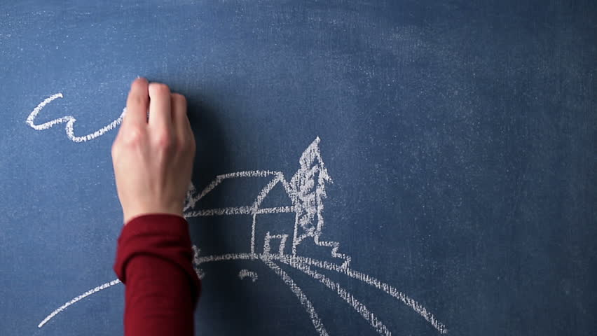 Chalkboard with hand and house drawing