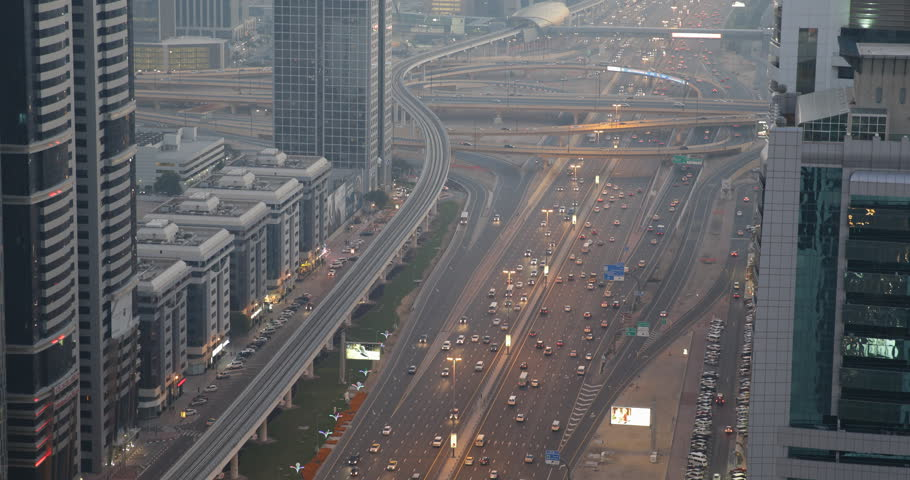 DUBAI, UAE - JANUARY 22, 2014 Establishing Shot Dubai Skyline Aerial View Highway Busy Street Cars Traffic Jam Commute Rush Hour ( Ultra High Definition, UltraHD, Ultra HD, UHD, 4K, 2160P, 4096x2160 ) | Shutterstock HD Video #8525485
