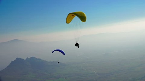 MACEDONIA, PRILEP, NOV 02, 2014, Ultra HD 4K Paragliders fly over amazing mountain range during paragliding extreme sport competition on 2 November, 2014 at Prilep, Macedonia