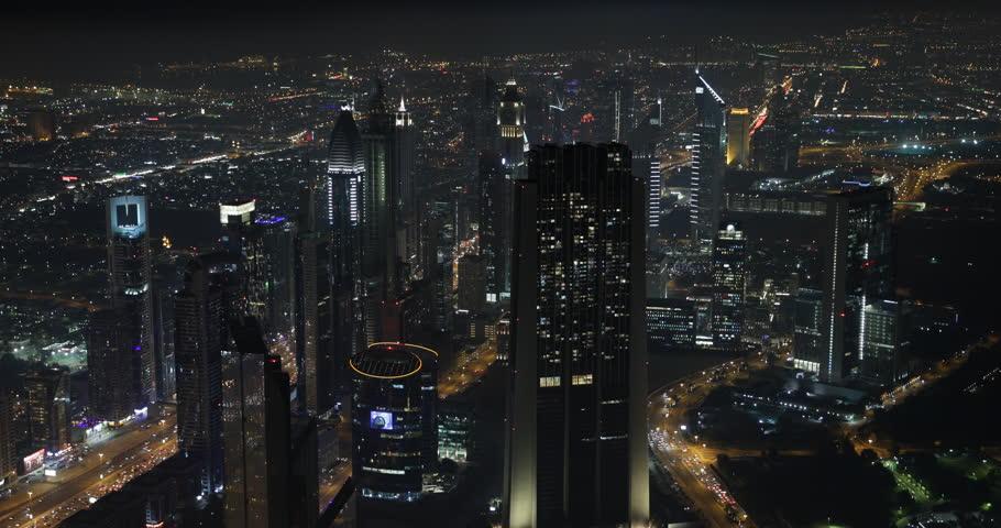 Night Illuminated Skyscraper Tower Office Building Dubai Skyline Cityscape Light ( Ultra High Definition, UltraHD, Ultra HD, UHD, 4K, 2160P, 4096x2160 ) | Shutterstock HD Video #8538811