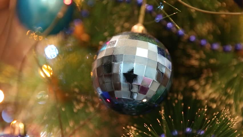 Christmas and New Year Decoration. Christmas ball hanging on a Christmas tree. Bright garlands | Shutterstock HD Video #8542495
