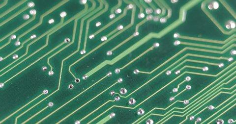 Technology Green Background Closeup Focus Mainboard Electronics Scheme Circuits ( Ultra High Definition, UltraHD, Ultra HD, UHD, 4K, 2160P, 4096x2160 )