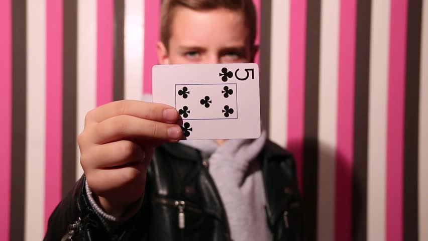 The Kid Running Card Tricks - Now You See Me - Snap Card Change. The kid running card trick in 3 variants. Card in focus, the boy is blurred, colorful background. Magician Changes Card.