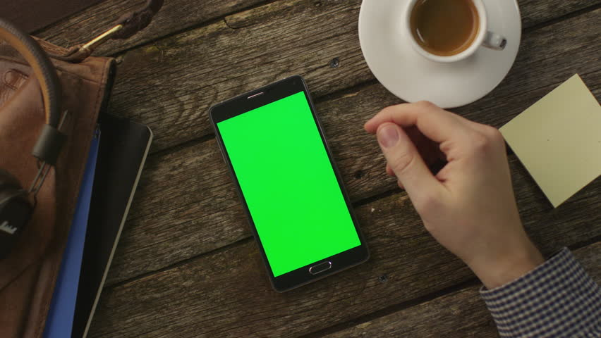 Using Android Phone Which Laying on Wooden Table at Home. Top View. Causal Lifestyle | Shutterstock HD Video #8563066