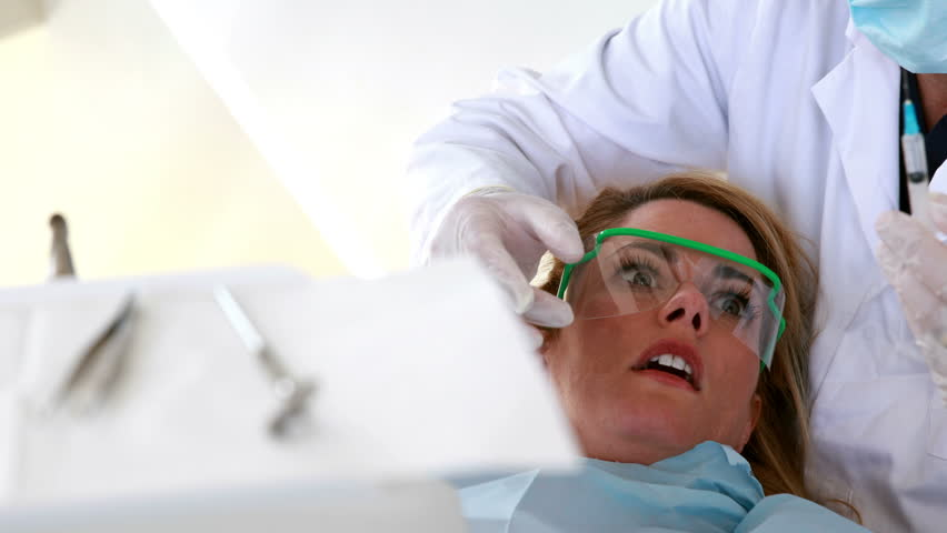 Terrified Patient Looking At Needle In Dentists Chair The Dental Clinic