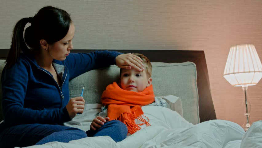 young mother and her sick son in bed stock footage video 8603530 shutterstock. Black Bedroom Furniture Sets. Home Design Ideas