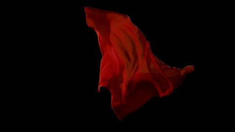 Red fabrics flowing in the air on black background. Slow motion