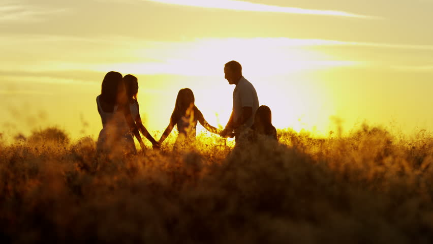 Social freedom young loving Caucasian family parents three sisters outdoor silhouette sunrise childhood innocence happiness together RED EPIC | Shutterstock HD Video #8672635