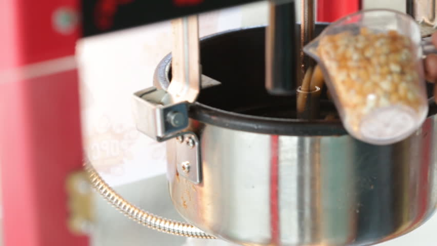 a static shot of a commercial popcorn machine hd stock footage clip