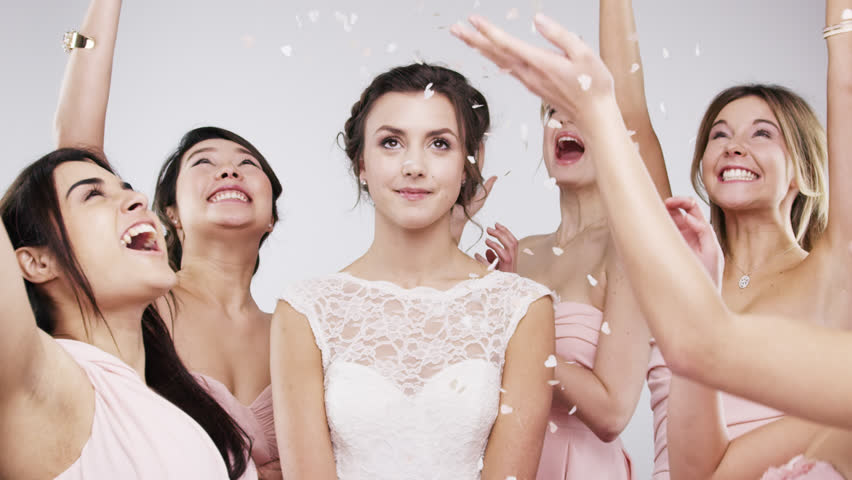 Beautiful bridesmaids throwing confetti slow motion wedding photo booth series