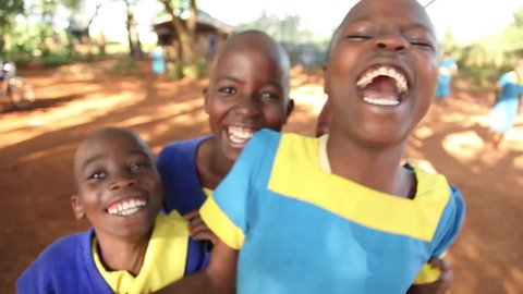 KAKAMEGA, KENYA - October 7th, 2014: Unidentified school children excited about their new water filtration system in Kakamega, Kenya. (For editorial use only.)