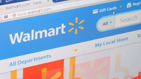 NEW YORK - FEB 11: Shopping online on Walmart website on February 11, 2015. Walmart is the world's largest company by revenue.