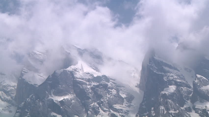 Medium Close Up Shot of snowy mountains and clouds at Gangotri in Uttarakhand, India | Shutterstock HD Video #8826955
