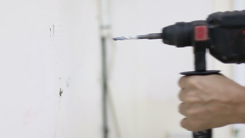 Drill, drill, concrete, electric drill,Close up hands hold electric drill in room, interior  and home renovation DIY concept.