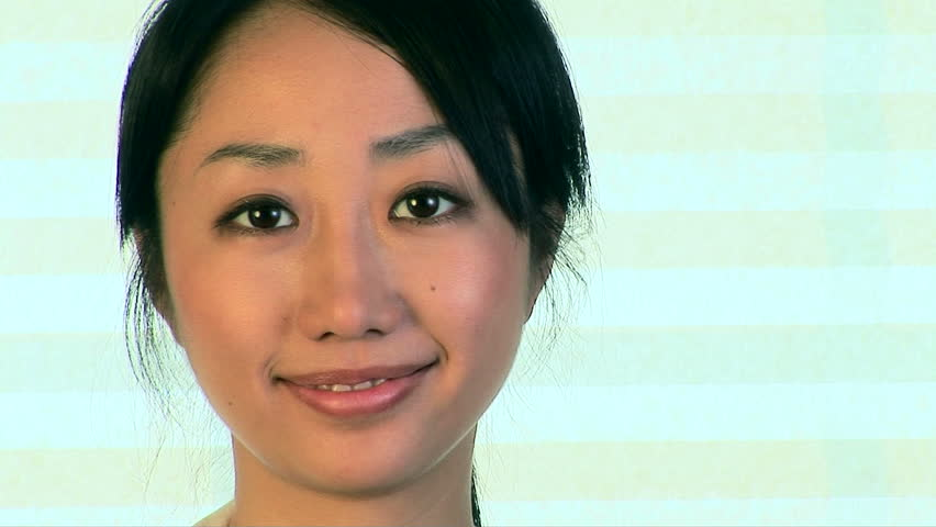 Close up portrait of smiling young Asian woman face