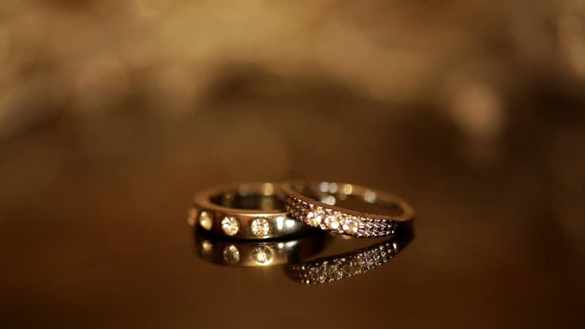 wedding rings rotating with textured background stock