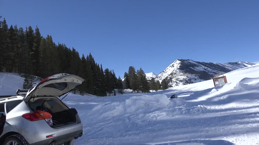 Snowmobile Trails Ahead/ All systems go for mountain snow adventures.