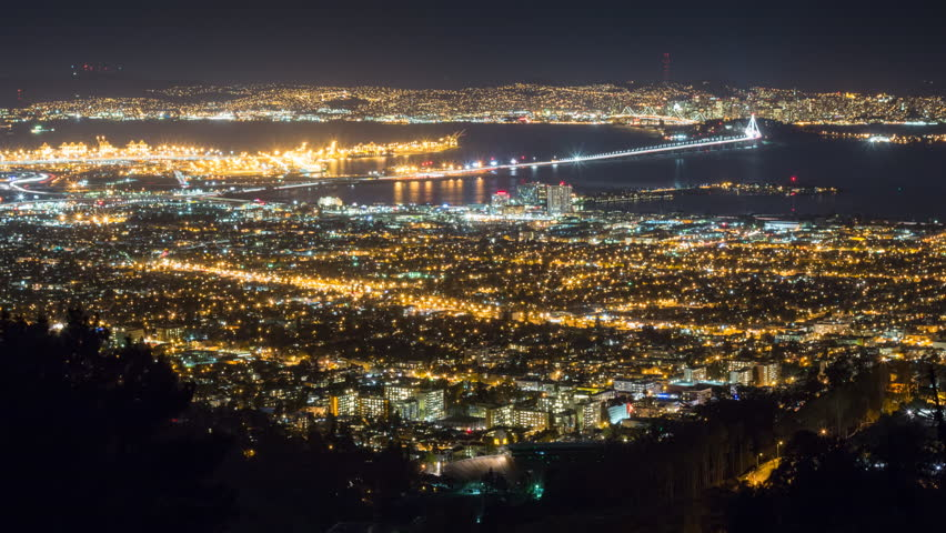 4k time lapse of San Francisco and other parts of the Bay Area including the new span of the Bay Bridge, shot from a high vantage point in the Berkeley hills. 1080p pan and zoom version also available | Shutterstock HD Video #8870956
