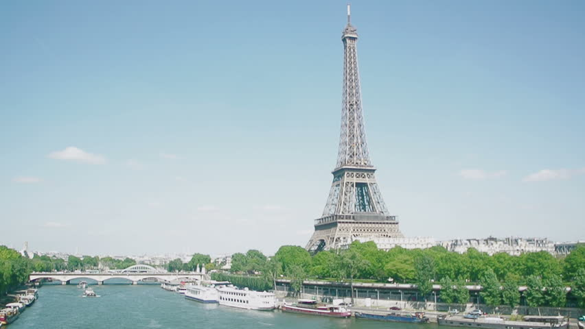 Eiffel Tower, Seine River, streets and homes with in heart of Paris seen by a drone