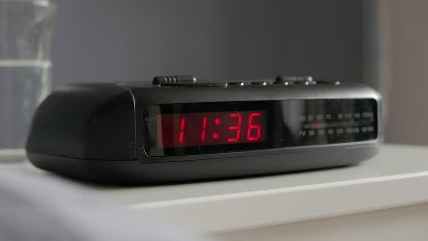 Tracking Into Digital Alarm Clock, Alarm Ringing 6am Stock