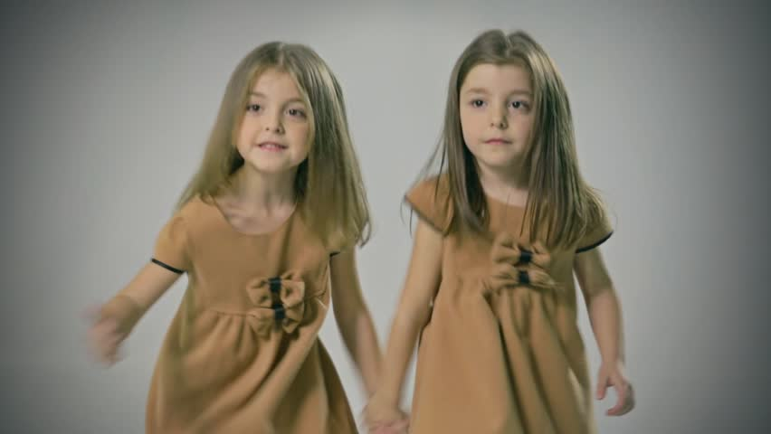 Good looking and loving twins. Sisters. Walking, Smiling, Playing. Adorable. Happy lifestyle kids.
