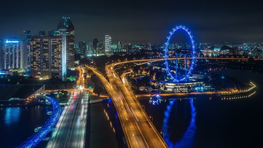 night light traffic road and famous singapore flyer 4k time lapse