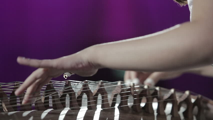 Chinese girl playing the national instrument