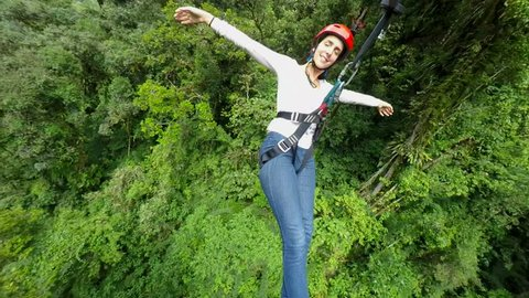 Young Women On Zip Line Over The Dense Rainforest , 3Rd Person Camera