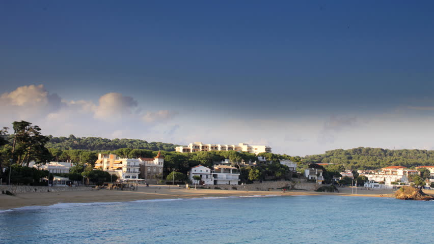panning timelapse in late afternoon, across the bay of la fosca, costa brava, spain